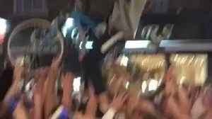 Cyclist Crowdsurfs in Gravesend During England World Cup Celebrations [Video]
