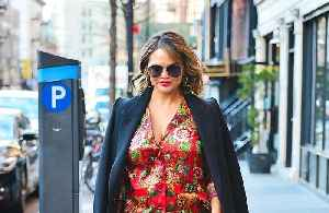 Chrissy Teigen hits back at critics over breastfeeding picture [Video]