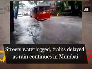 Streets waterlogged, trains delayed, as rain continues in Mumbai [Video]