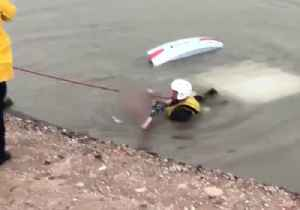 News video: Mesa Firefighter Pulls Woman From Car Submerged in Canal