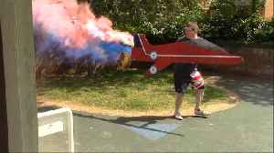 Watch Hilarious Dad Recreate Red Arrows Flypast - Complete With Smoke [Video]