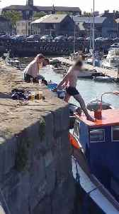Guy Tries to Jump on Top of Boat [Video]
