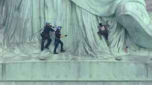 Police seize woman who clambered up Statue of Liberty [Video]
