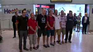 UK divers who helped rescue Thai boys return home [Video]