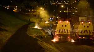 Londonderry rioters throw petrol bombs at police vans [Video]