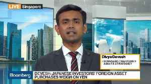 Yuan May Weaken Further in Next Few Months, StanChart's Devesh Says [Video]