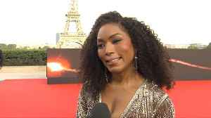 Angela Bassett Is Interrupted By Tom Cruise At Paris Premiere [Video]