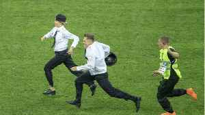 Anti-Kremlin Intruders Run On Pitch During World Cup Final [Video]