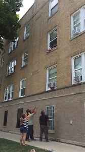 Toddlers Dangling out of Second Floor Window [Video]