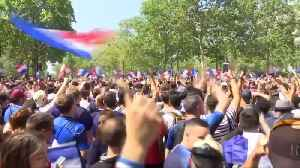 Crowds of excited French fans gather in Paris for World Cup final [Video]