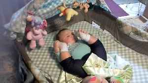 Baby Sleeps With Legs Up In The Air [Video]