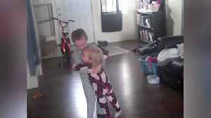 A Young Boy Dances With His Little Sister In His Arms [Video]