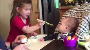 Toddler Girl Shows Her Father How To Feed The Baby [Video]
