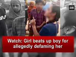 Watch: Girl beats up boy for allegedly defaming her [Video]