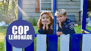 Lad desperate to be a police officer set up a stall serving lemonade and donuts to cops [Video]