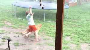 Kid Races Into Monsoon To Jump On Trampoline [Video]