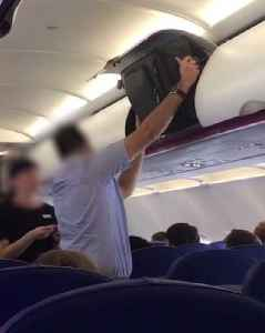 Man Struggles to Fit Small Carry-On Bag in Overhead Bin [Video]