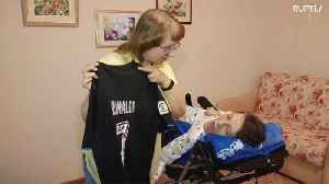 9 y/o donates shirt signed by Ronaldo to fan with cerebral palsy [Video]