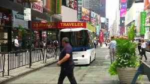 A driverless shuttle in Times Square [Video]