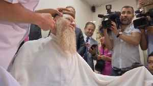 Turkish politician bids goodbye to two-year-old beard after end of emergency rule [Video]