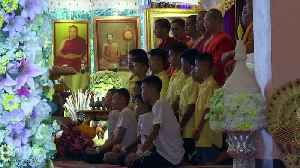 Rescued Thai footballers attend Buddhist ceremony near cave [Video]