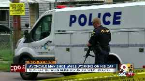 Man shot while workking on his car [Video]