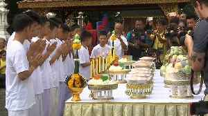 Thai cave boys and their coach attend Buddhist temple ceremony [Video]
