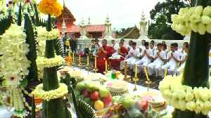 Candles and chanting: Thai cave boys in ceremony to become Buddhist novices [Video]