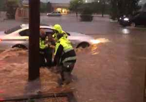 People Rescued From Car Stuck in Santa Fe Floodwaters [Video]