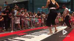 Big on giant piano [Video]