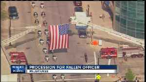 Community pays respects to officer at procession [Video]