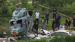 Watch: Helicopter crashes in Beijing, injuring 4 [Video]