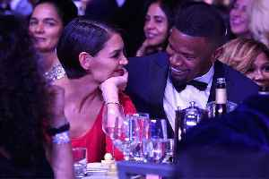 Jamie Foxx and Katie Holmes 'Go Bold' On the Beach [Video]