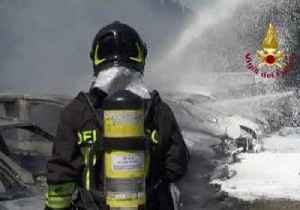 Italian Firefighters Hose Down Vehicles, Structures on Fire from Bologna Highway Explosion [Video]