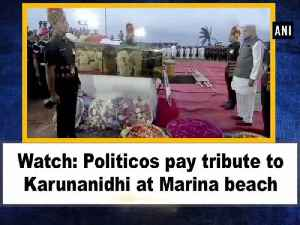 Watch: Politicos pay tribute to Karunanidhi at Marina beach [Video]