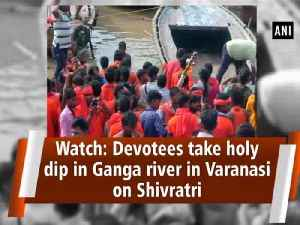Watch: Devotees take holy dip in Ganga river in Varanasi on Shivratri [Video]