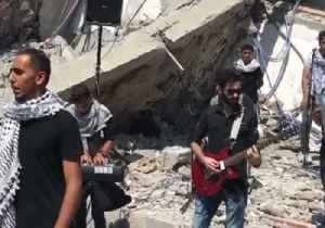 Palestinian Musicians Perform in the Rubble of Building Destroyed by Israeli Strikes [Video]