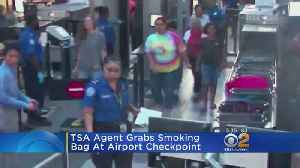 TSA Agent Grabs Smoking Bar At Airport Checkpoint [Video]