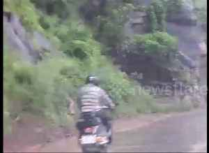 Close call: motorcyclist avoids landslide by inches [Video]