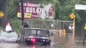 News video: New Jersey officer saves bride stranded in floodwater