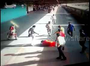Hero cop saves woman from getting crushed under train [Video]