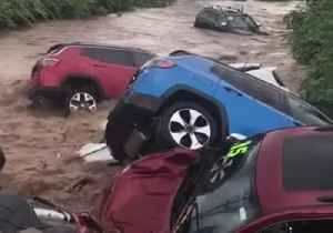 Flood Waters Sweep Away Cars From New Jersey Dealership [Video]