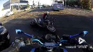 Motorcyclist gets rammed in narrow traffic jam [Video]