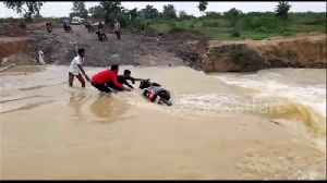 Video shows rushing floodwaters washing away locals' motorcycle in north India [Video]