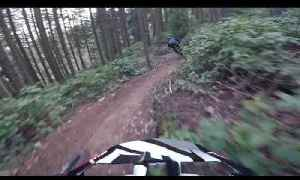 Mountain Bikers Speed Downhill Through Forest [Video]