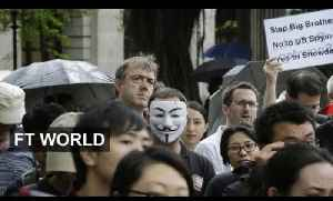 Hong Kongers march in support of Snowden [Video]