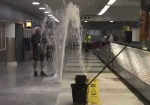 Excess Rainwater Bursts From Ground Near Baggage Claim at New York's JFK Airport [Video]