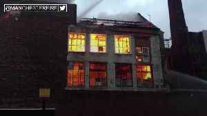 Firefighters tackle blaze at mill in Manchester [Video]