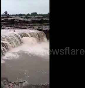 Eleven people rescued after being swept away by strong current [Video]