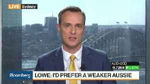 RBA's Lowe Sees Rates Steady `For a While Yet' [Video]